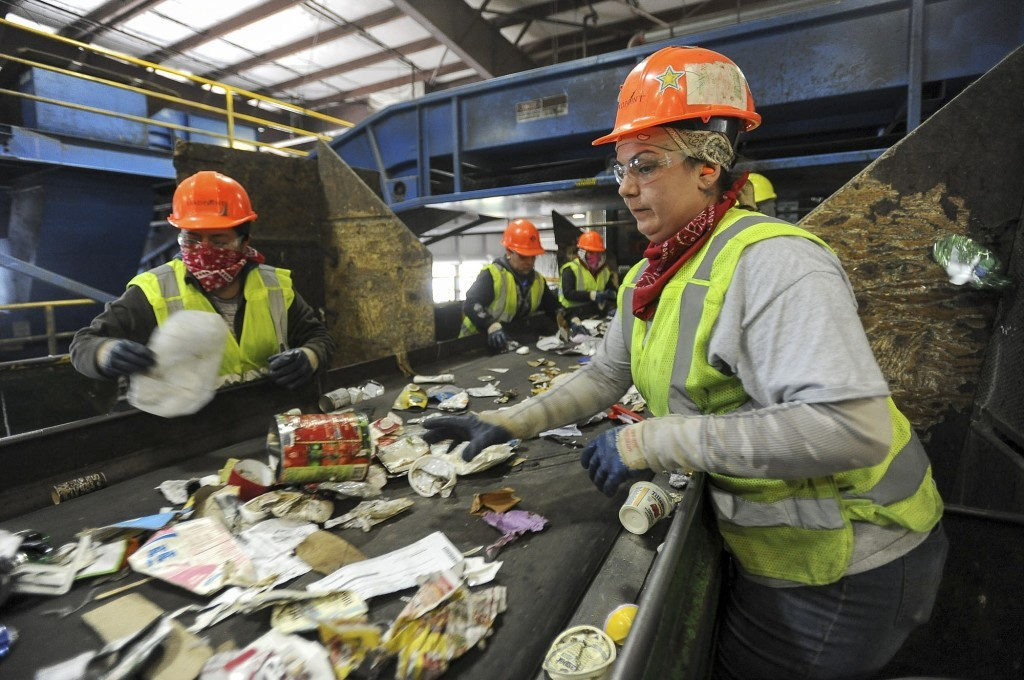 Staff recycling waste at factory